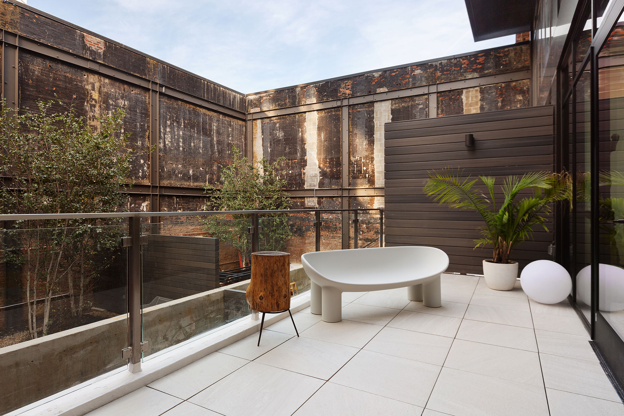 Outdoor Space Design with Preserved Original 1903 Walls The Bath Haus Interior Design by Meshberg Group