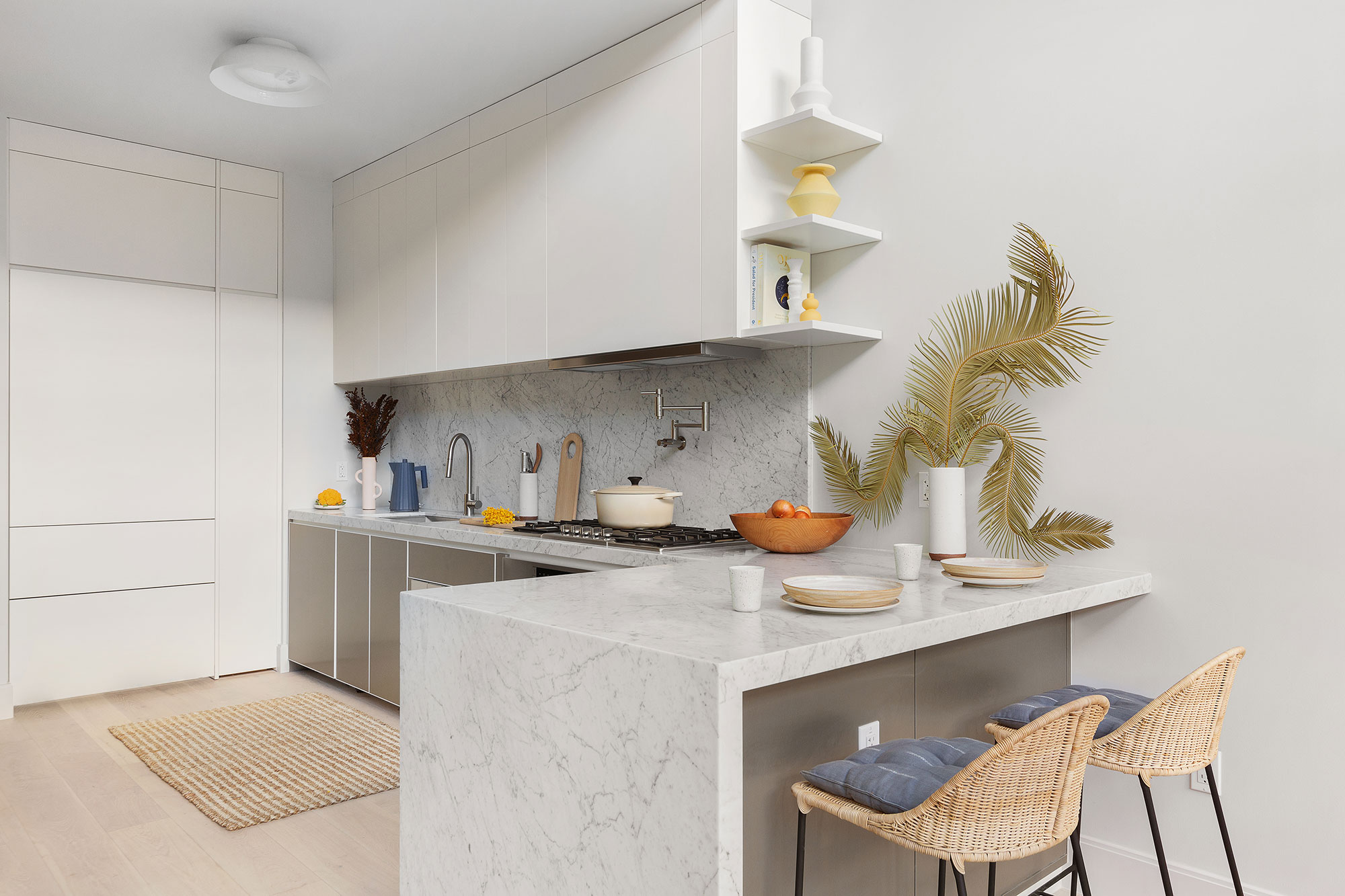 Custom White and Metallic Duo Tone Contemporary Kitchen with Marble Waterfall Island Interior Design by Meshberg Group