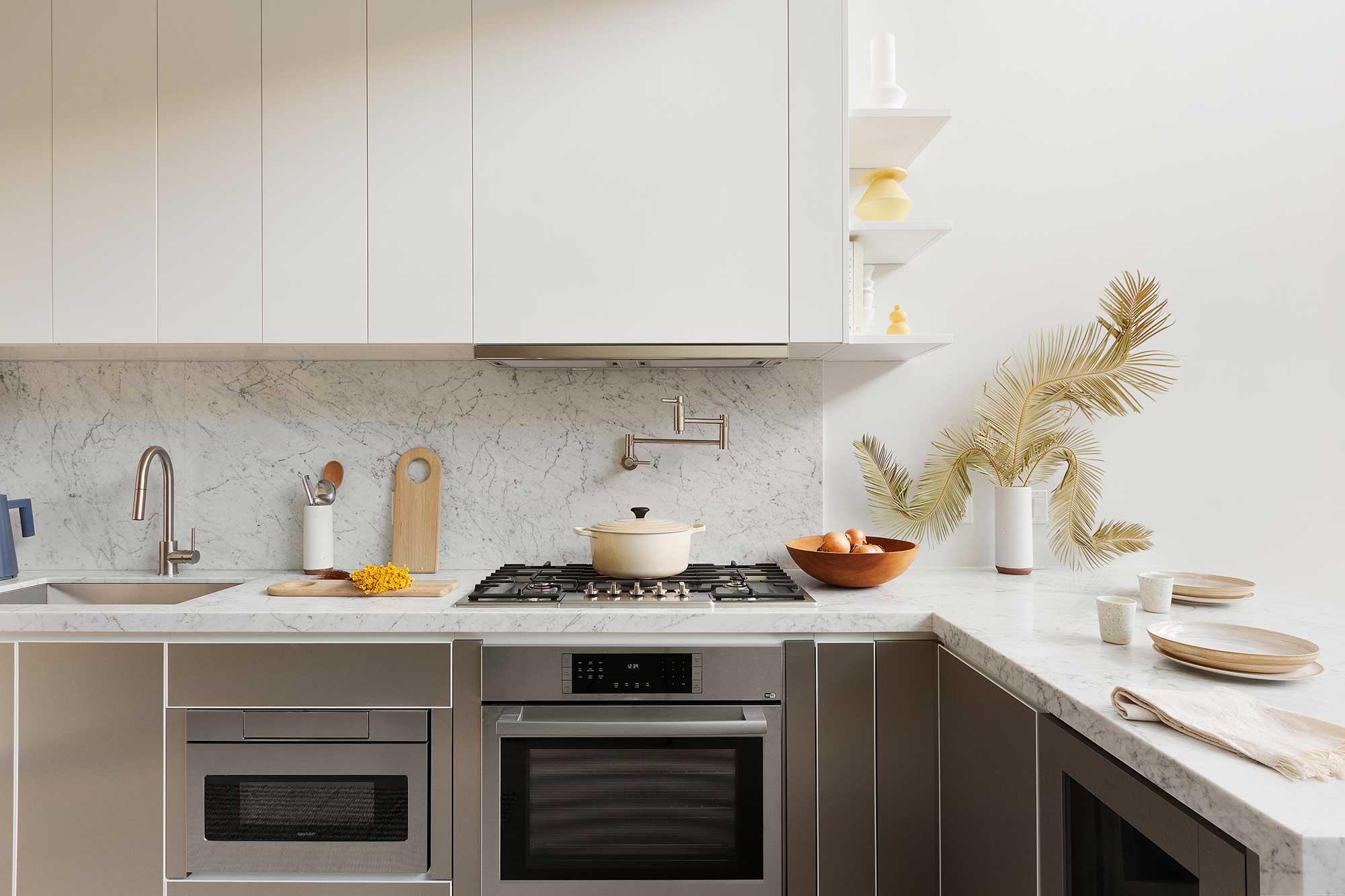 Custom White and Metallic Duo Tone KitchensThe Bath Haus Interior Design by Meshberg Group
